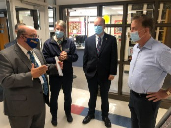 Vernon Superintendent of Schools Dr. Joseph P. Macary, left, explains how Vernon has safely reopened schools to Governor Ned Lamont, right, and (left to right) state Rep. Timothy Acker, R-Coventry and Vernon Mayor Daniel A. Champagne. Governor Lamont visited Vernon's Skinner Road School on Tuesday, September 1, 2020.