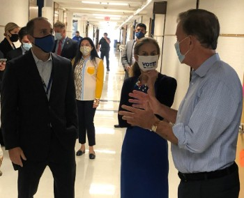 Skinner Road School principal Bryan Kerachsky, left, speaks with Governor Ned Lamont, right, and Lieutenant Governor Susan Bysiewicz. Lamont and Bysiewicz visited Vernon's Skinner Road School on Tuesday, September 1, 2020.