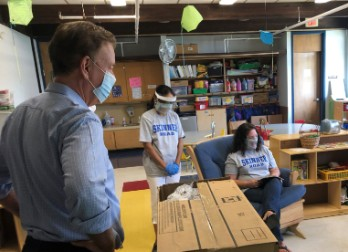 Governor Ned Lamont watches as kindergarten teacher Sue Zylberman, seated, and paraprofessional Usha Sridhar lead a pre-kindergarten class at Vernon's Skinner Road School on Tuesday, September 1, 2020.