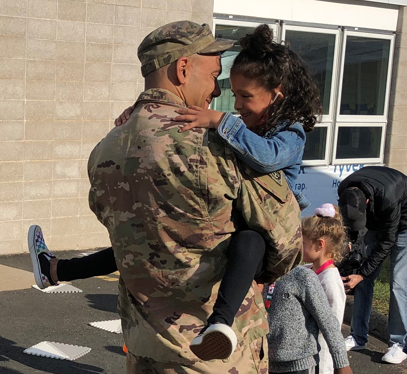 Connecticut Army National Guard Sgt. First Class David Flint returned from deployment Sunday and surprised his daughter Ella Monday morning at Lake Street School, where she is a kindergartener.