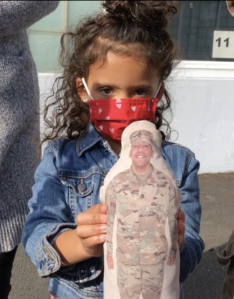 "Ella Flint holds a ""stuffy"" of her dad. He just returned from deployment to Jordan."