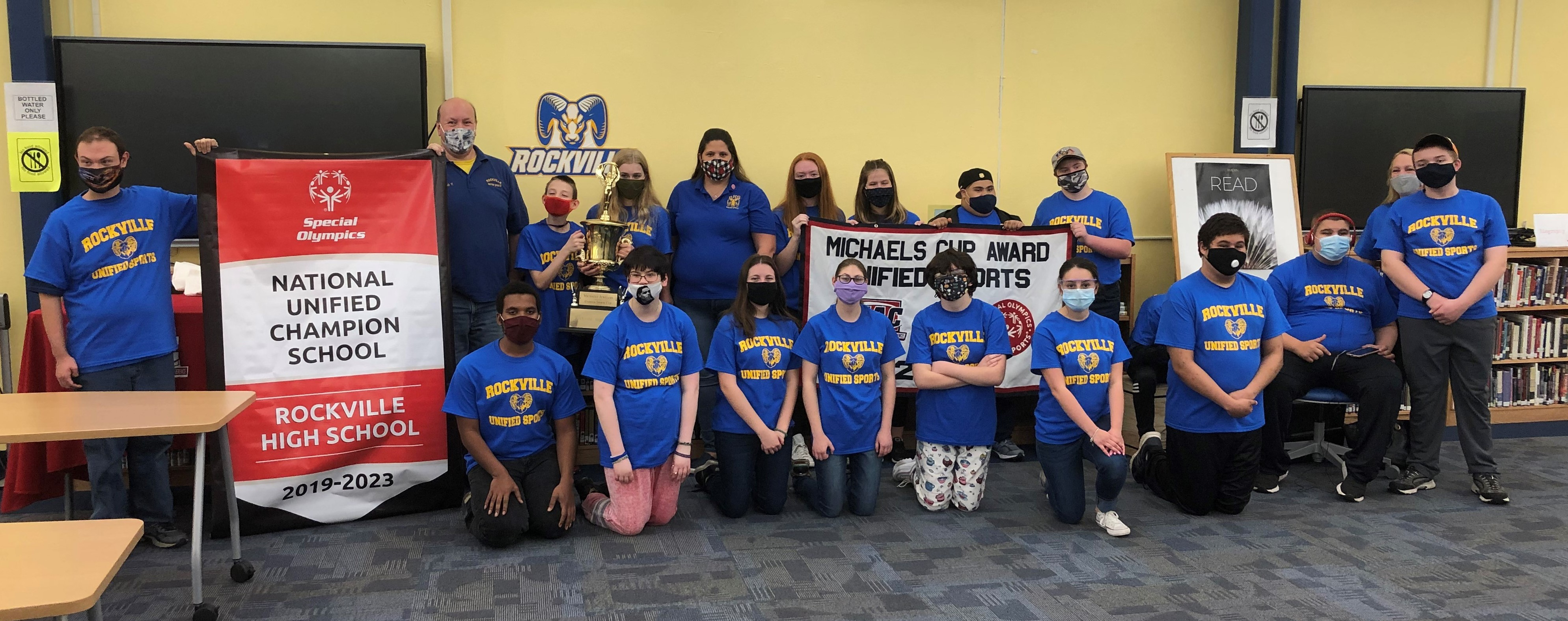 Rockville High's Unified Sports team with the Michaels' Cup and National Banner..